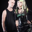 Couple of cyber punk girl with green blond hair and punk man with mohawk haircut. Isolated on black background. Studio shot. — Stock Photo #12400562