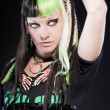 Cyber punk girl with green blond hair and red eyes isolated on black background. Expressive face. Studio shot. — Stock Photo #12400584