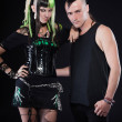Couple of cyber punk girl with green blond hair and punk man with mohawk haircut. Expressive faces. Isolated on black background. Studio shot. — Stock Photo