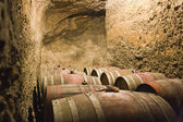 Barrels in a wine cellar — Stock Photo