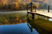 Autumn morning at the lake near a forest — Stock Photo