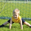 Stock Photo: Young boy or kid plays soccer or football sports for exercise an