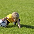 Young boy or kid plays soccer or football sports for exercise an — Stock Photo #11074348