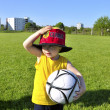 Young boy or kid with German cap plays soccer or football sports — Stock Photo