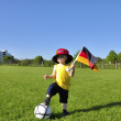 Young boy or kid with German flag and cap plays soccer or footba — Stock Photo #11074388