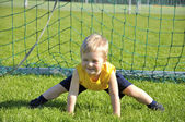 Young boy or kid plays soccer or football sports for exercise an — Stock Photo