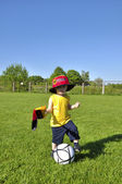 Young boy or kid with German flag and cap plays soccer or footba — Stock Photo
