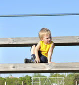 Young boy or kid plays soccer or football sports for exercise an — Stok fotoğraf