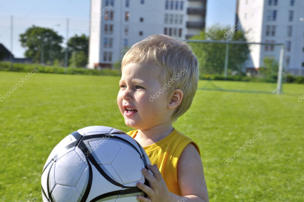 Young boy or kid plays soccer or football sports for exercise and activity. — Stock Photo #11074363