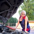 Stock Photo: Beautiful woman repairing the car