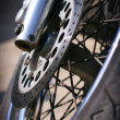 Front wheel of the motorcycle — Stock Photo #11619229