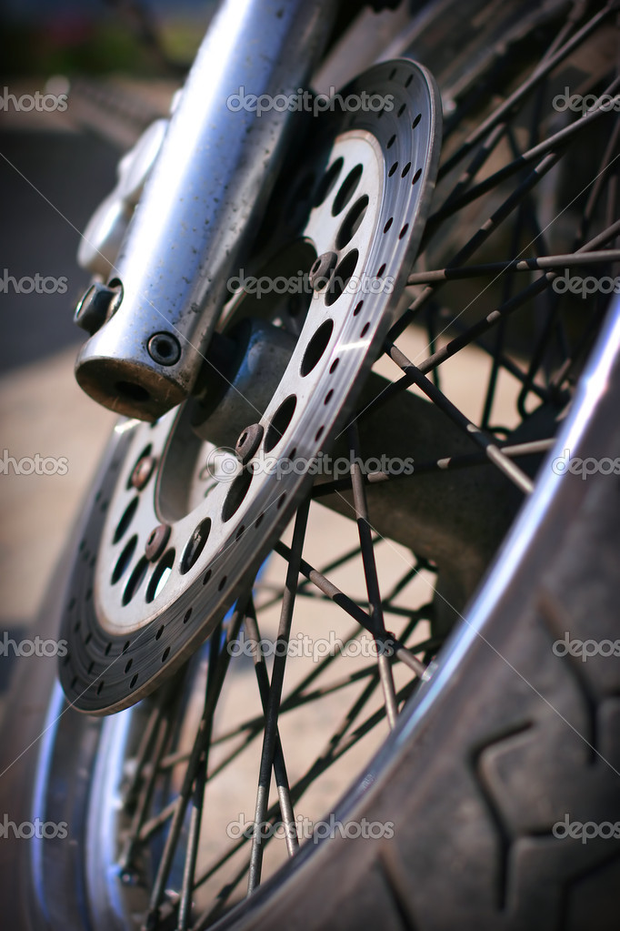 Front wheel of the motorcycle close-up — Stock Photo #11619229
