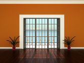 Empty interior room with orange walls, flowers and windows to the terrace — Stock Photo