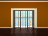 Empty interior room with orange walls and windows to the terrace — Stock Photo
