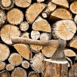 Stock Photo: Woodpile and axe