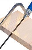 Saw sawing board. — Stock Photo