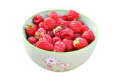 Raspberries fruit in a green bowl, white background — Stock Photo