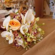 Bride and Groom Table with Bride's Bouquet at Wedding Reception — Stock Photo #10773956