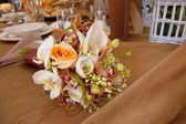 Bride and Groom Table with Bride's Bouquet at Wedding Reception — Stock Photo