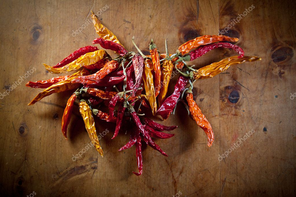 Dried peppers on an old wooden table.  Stock Photo #11119234