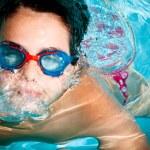 Kid swimming — Stock Photo #11521279