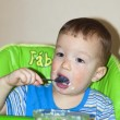 Hungry boy eating — Stock Photo