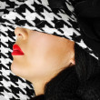Red lips and white black hat — Stock Photo
