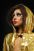 Girl in gold hood mante — Stock Photo