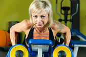 Exersice with dumbbells — Stock Photo