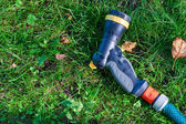 Garden sprayer for water lying on the grass — Stock Photo