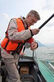 A fisherman wearing a life jacket. — Stock Photo