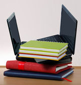Stack of book with a laptop — Stock Photo