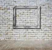 Old frame against wall — Stockfoto