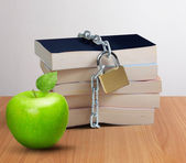 Stack of book and green apple — Stock Photo