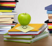 Stack of books and apple — Stock Photo