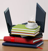 Stack of books with a laptop — Stock Photo