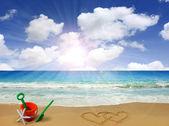 Drawn hearts in beach — Stock Photo