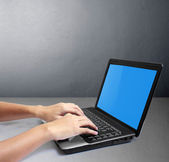 Hands on a laptop — Stock Photo