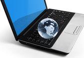Globe on keyboard — Stock Photo