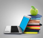 Red apple on books ands laptop — Stock Photo