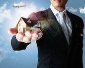 House in hands — Stock Photo