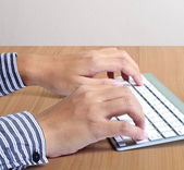 Hands typing on the computer keyboard — Stock Photo