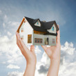 House in hands — Stock Photo #11527352