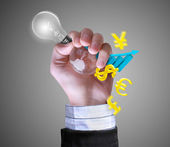 Light bulb and business in hand — Stock Photo