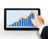 Pointing on touch screen graph on a tablet — Stock Photo