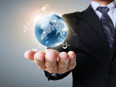 Globe in his hands — Stock Photo