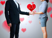 Women with a man with a heart — Stock Photo