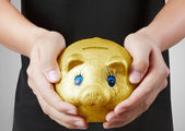 Man with the piggy bank — Stock Photo