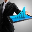 Businessmen and ,graph on a tablet — Stock Photo