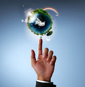 Pointing glowing earth globe — Stock Photo